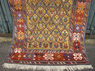 An antique late 19th century yellow ground Daghestan rug. 8ft3 x 3ft10. Very good original condition with original sides and end finishes , good pile, very minor crease marks to side and  ...