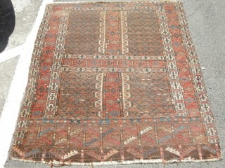 An Antique Yomut Ensie, some damage but mainly in pile will clean well very dirty nice colours. 4ft8 x 4ft approx.,