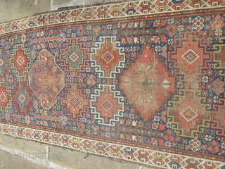 a very beautiful mid or early 19th century nw persian ?kurdish runner. Approx 15ft x 3ft. I think it's missing an outer guard there are condition issues. Low parts two very old  ...