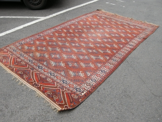 A good late 19th century Yomut carpet approx 9ft6 x 5ft6. Generally sound condition, some low area to the centre and damage to one end, can be repaired or used as is.  ...