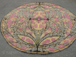 An interesting French art deco carpet 7ft x 7ft circular in reasonable condition one small area of colour run otherwise good pile.
