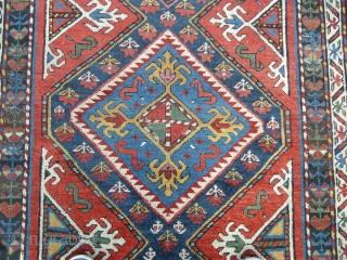 A great coloured south Caucasian long rug 19th century all good colour including cochineal. Approx 10ftx3ft6. Some corrosion bud good pile. Wonderful saturated colours.
