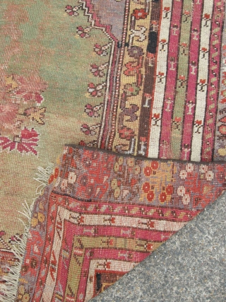 Antique Turkish prayer rug green ground, 145x 115 cm, damage and old repairs, good colours .