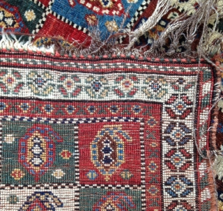 Pretty small Qashqayi rug with variant forms of Boteh in cartouches .