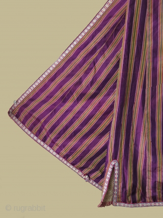 """Uzbek large size silk ikat chapan. Cotton lining. Size: Arms spread out 77.9"""" - 198 cm, Height 55.1"""" - 140 cm and skirt 53.1"""" - 135 cm."""