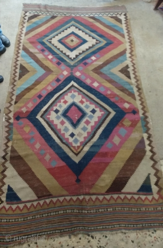 Antique Qashqai kilim. Some old restorations done on it and some other areas need more. Found as it is. Size: 137 cm x 270 cm.