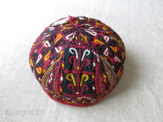 "Turkmenistan Tekke tribal skullcap /hat, Fine embroidery on silk with traditional Tekke motifs. Small amulet added on top for protection. Lined with printed cotton. Size: 6"" in diameter - 3"" high -  ..."