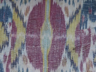 "Uzbekistan - Khorazm Khiva Ikat chapan, evenly worn, printed cotton lining - ikat facing. Size: arm to arm 50"" - 49"" tall. Circa 1920 - 1930s."