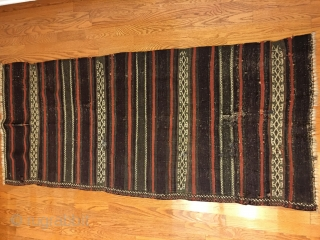 Antique Balouch Kilim with all good colors including generous amounts of aubergine. Old repairs and wear as seen in photos, otherwise in good condition.