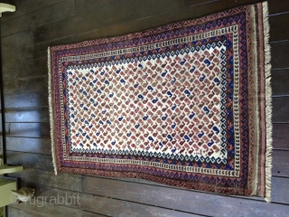 Early Baluch rug, probably from 3rd Qtr 19th Century or earlier. Unusual white field background filled with tiny botehs. Soft thin floppy handle. Low pile throughout and some oxidation of browns. Exhibits  ...