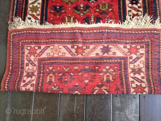 Antique Kuba rug, dated 1314/1896-7. All organic colors. Wonderful well-balanced palette with small tulips in an insect red field. Some limited areas of low pile and wear, otherwise good low to medium  ...