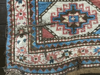 "Antique Moghan Kazak Fragment. Cut and shut and both ends then sewn together and with a large patch and a 4""slit. Some good pile but overall rough condition.
