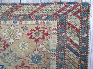 Early Shirvan snowflake design rug, ca 1870. Good natural colors, very low evenly worn pile. Exceptional palette reflecting good age. Missing outer borders on both ends. Yellow field and good variety of  ...