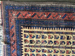 Unique Antique Baluch rug. Early example. Worn condition with some knots showing. All colors derived from natural dyes. Natural camel hair field containing several rows of the tree of life/bird design. Size:  ...