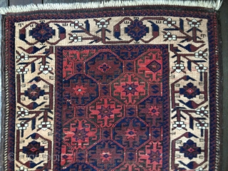 Antique Baluch rug, circa last quarter 19th C. All colors derived from natural dyes. Rare aubergine field. Abrashes as seen in photos. Good medium pile, lower in center. Soft,thin blanket-like handle. Unusual  ...