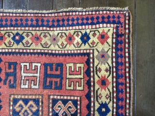 Beautiful small Kazak rug circa 1880s. All natural colors including a lemon-yellow border. Excellent condition with some professional reweaving in the field. 