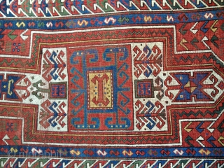 Small Antique Sewan Kazak rug, probably late 19th C. Bright saturated natural colors including nice lemon yellow and a generous use of green. Condition: even wear with some knots showing. No repairs  ...