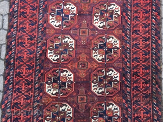 A Baluch interpretation of a Turkmen Tekke pattern: antique Baluch rug, size: ca 197cm x 102cm / 6'5''ft x 3'4''ft
