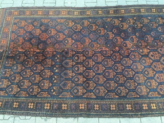 This unusual large antique Baluch rug from West - Afghanistan was woven in two parts. It has long kilim ends. Good overall condition. Size: ca. 280cm x 135cm / 9'2''ft x 4'4''ft  ...