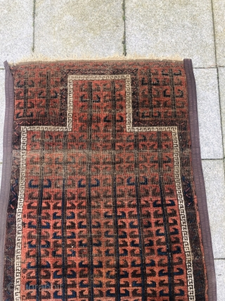 Antique Baluch prayer rug, a very old example with a rare archaic design. Size: ca. 165x85cm / 5'4''ft by 2'8''ft
