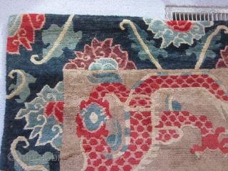 Tibetan: Plush khaden, Two red dragons seeking the flaming pearl, framed by indigo ground main border. Excellent condition, c.1920
