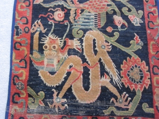 Tibetan: Khaden, Double dragon/ phoenix motif, ti9ghtly woven but with visible condition issues on the edges and plle. c.1900