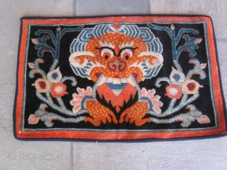 Pair of Tibetan mats, c.1930. Very graphic depiction of a Tibetan monster in vibrant (mostly) chemical colors. If you can name the monster correctly, there will be a healthy discount. SOLD