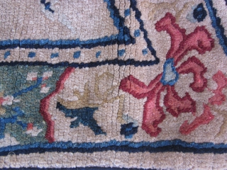 Tibetan butterfly-type saddle, c.1930. Colorful, well-designed border, with dragon stretching to grab the flaming pearl!