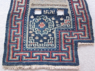 """Tibetan : Vintage notched saddle bottom rug, 2"""" by 3'8"""", before 1900. Some re-piling around one cinch strap."""