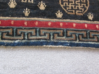 "Tibetan : Table mat with two medallions, central endless knot motif, 1'3"" by 3'. Some repair to lower border. c.1925"