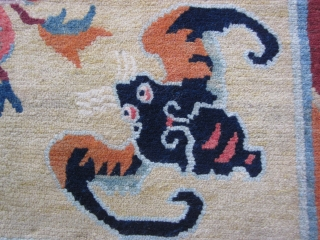 Tibetan mat, abt 3 by 3 ft, c.1930 Sinicized design with four hungry bats ready to feast on the three fruits