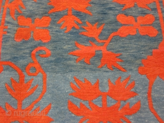 "Tibetan khaden, striking design with red-orange floral elements on abrashed blue-green ground,tightly woven with great wool 2'10"" by 5'6"", c.1920-30"