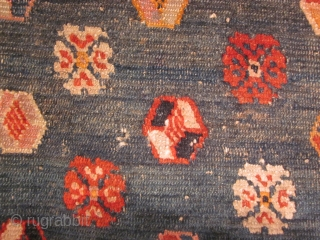 Tibetan horse cover, large fragment on green ground with scattered abstract flowers. Thickly woven. Early 20th C?