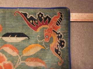 Tibetan mat. Bats with lotus on soft green ground. c.1920