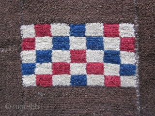 Tibetan tsuk truk, three panels, 27 by 46 inches, very unusual design with opposing red white and blue checkered rectangles and a triangular design ( sitting bird?) of natural wool, all on  ...