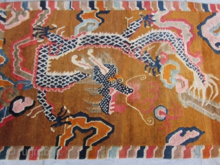 "Tibetan khaden with monster dragon cavorting through an orange-grounded, hallucigenic, cloud-banded sky.Don't miss the flaming pearl! Strikingly graphic. c.1920-30 2'10"" by 5'8"" POR"