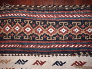 South West Iran, Qashqai Colahlo opened out camel bag, early 20th c. white cotton and undyed wool field with overstitched motifs, goat wool handles and trim, a few stains to the cotton  ...