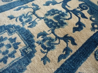 Tibetan or Chinese rug, 130x65cms, thick lustrous even pile in blues, undyed white and a small amount of ochre, excellent original condition without loss or repairs.