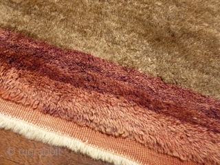 Chunky, hard-wearing Karapinar tulu with soft shiny wool, 240x117cms, mid 20th c. undyed field, good condition.