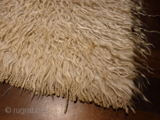 Angora tufted tulu from Karapinar, undyed wool, 143x125cms, mid 20th c. excellent condition, ideal for Scandinavian interior with a log fire.