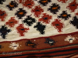 Bakhtiari nomads bread-making sofreh from western Iran, 126x108cms, white cotton ground with red, blue, white and orange wool details, sturdy interlocking weave typical of Bakhtiari kilims (see reverse), about 50-60 yrs old,  ...