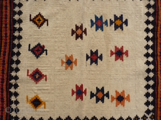 A Qashqai sofreh with an undyed natural wool background. 124x80 cms (k1601188)
