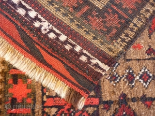 A fantastic Belouch rug with mainly undyed camel wool. It is loosely woven, with a floppy handle. The wool is lustruous, soft and shinny. The central tree is great with all the  ...