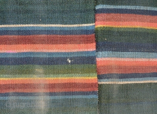"""Tibetan woman´s apron or """"Pangden"""", very fine woollen flatweave, woven in one long thin strip, cut and sown together. Good colours and age with patina of use. Nice greens predominate. A few  ..."""
