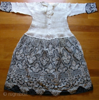 Priests funerary garment, North of Spain, 19th C.   Starched, pressed and baked linen to the shirt with intricate lacework to the skirt. Noteworthy are the very fine and delicate Flor de Lis  ...