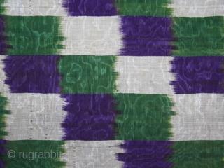 "Ikat fragment.Silk. Uzbekistan. Central Asia. Circa 1900's. Very good condition. Cm. 42 x 50 (1'5"" x 1'8""). Sewn onto a cotton textile and mounted on a wooden frame."