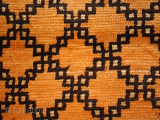Pile carpet cod. 0510. Wool traditional dyes. Ait Ouaouzguite tribe. High Atlas area. Morocco. First half 20th. century. Fair condition with some holes and moths bytes. Cm. 155 x 337 (61 x  ...