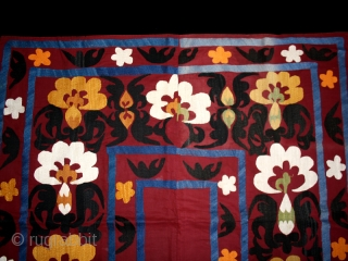 "Suzani. Silk embroidery on cotton. Uzbekistan. Central Asia. Second quarter 20th. century. Perfect condition. Cm. 110 x 215 (3'7"" x 7'). Backed with a Russian trade textile."