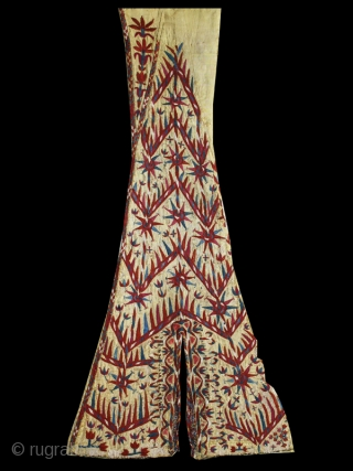 Woman's yellow Chyrpy fragment cod. 0679. Silk embroidery on silk. Turkmen people. Central Asia. Early 19th. century. Cm. 42 x 81 (16.5 x 32 inches).   Sewn onto yellow silk and mounted  ...