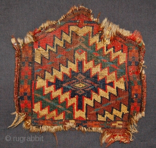 Antique Yomut camel knee cover.25 x 24 cm.Dirty and damaged but seems older than most of this type.19th.c.